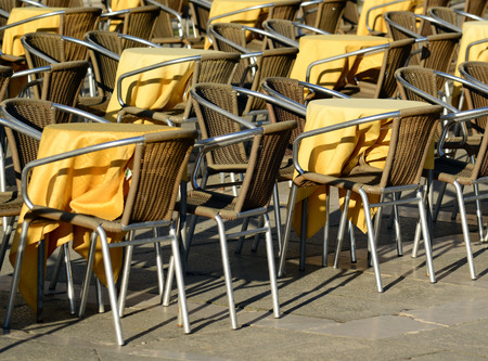 brak: Street view of a coffee terrace with tables and chairs