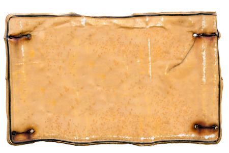 Rusted empty metal plate isolated on white background