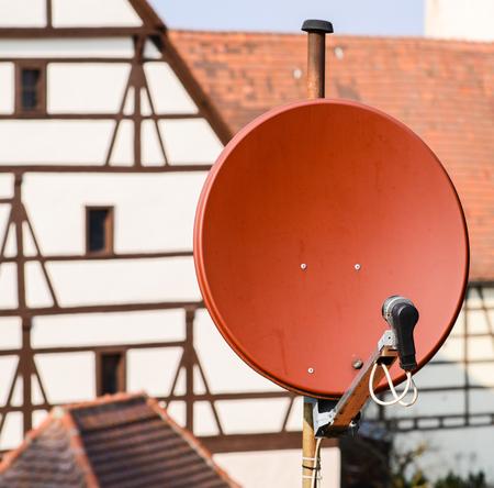 satelite: Satelite dish on roof