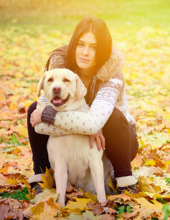 endear: Brunette girl with dog in nature