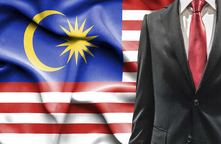 undercover agent: Man in suit from Malaysia Stock Photo