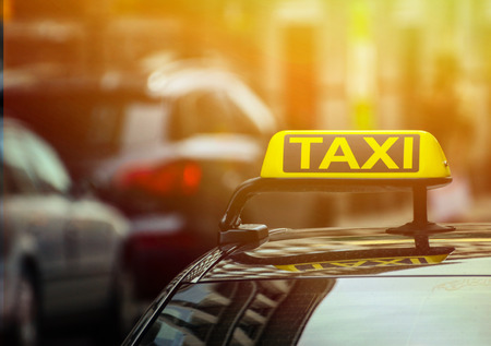 taxi sign: Taxi sign on car Stock Photo