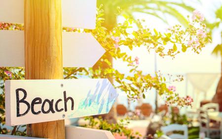 beach access: Beach sign pointing at beach