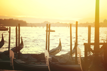 Beautiful sundusk in Venice with gondolas photo