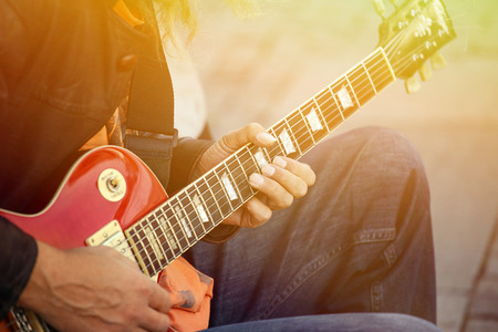 acoustical: Man playing guitar on street