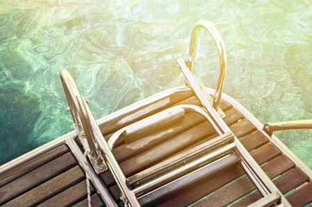 black moor: Abstract view of yacht stairs and sea water Stock Photo