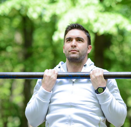 pullups: Crossfit man working out pull-ups on chin-up bar