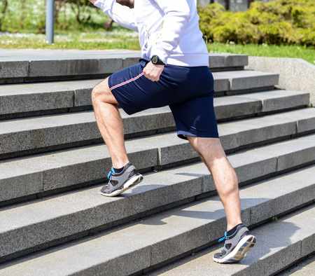 Practice - Close up of young man running up the stairs Imagens