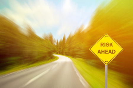 financial risk: RISK AHEAD sign - Business concept