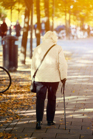 incapacitated: Old lady walking with stick