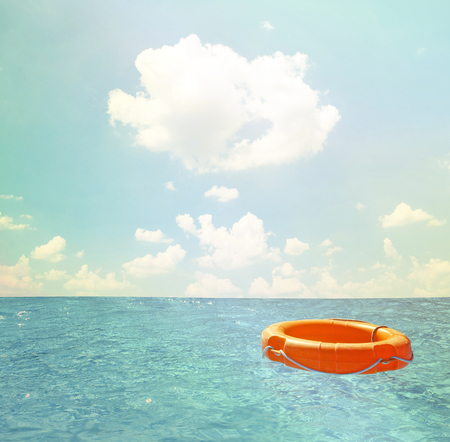 water basin: Help concept - Life buoy at open sea Stock Photo