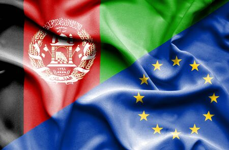 european union: Waving flag of European Union and Afghanistan
