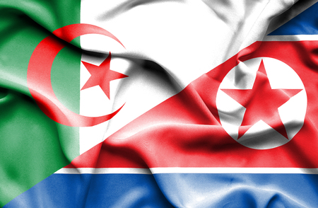 korea: Waving flag of North Korea and Algeria