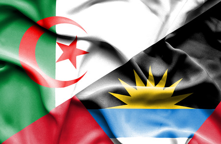 antigua: Waving flag of Antigua and Barbuda and Algeria Stock Photo
