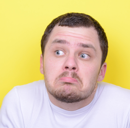 stumped: Portrait of funny cluelles man against yellow background