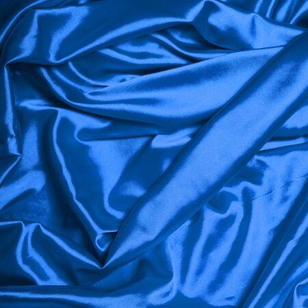 blue silk: Smooth elegant blue silk background Stock Photo