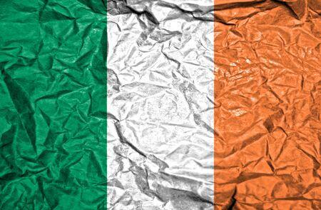 irish history: Ireland vintage flag on old crumpled paper background Stock Photo