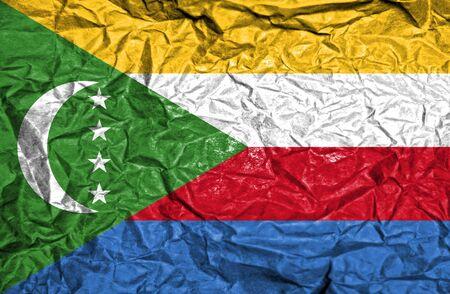 comoros: Comoros vintage flag on old crumpled paper background