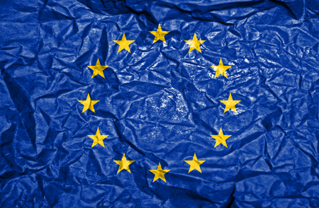 european: European Union vintage flag on old crumpled paper background