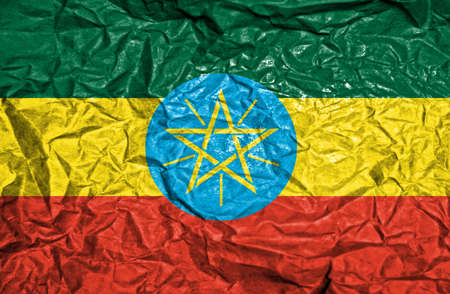 ethiopia abstract: Ethiopia vintage flag on old crumpled paper background
