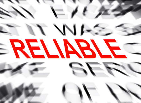 reliable: Blured text with focus on RELIABLE Stock Photo