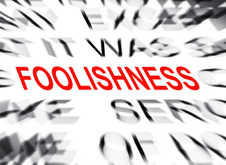 foolishness: Blured text with focus on FOOLISHNESS