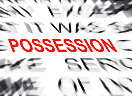 data dictionary: Blured text with focus on POSSESSION Stock Photo