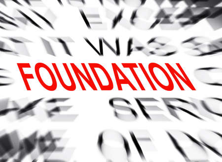 define: Blured text with focus on FOUNDATION Stock Photo