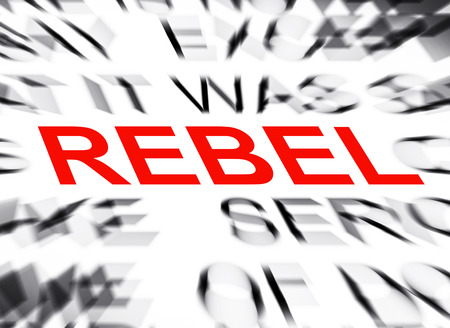 to rebel: Blured text with focus on REBEL