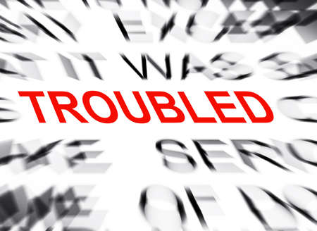 troubled: Blured text with focus on TROUBLED