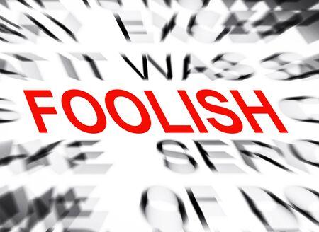 foolish: Blured text with focus on FOOLISH