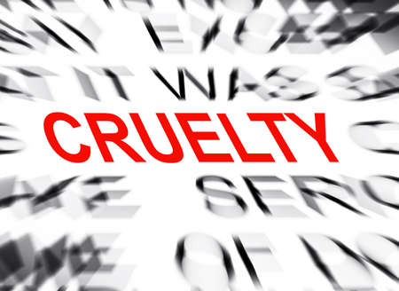 cruelty: Blured text with focus on CRUELTY Stock Photo