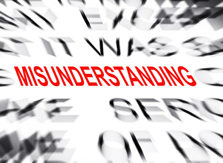misunderstanding: Blured text with focus on MISUNDERSTANDING Stock Photo