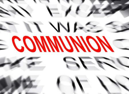 definition define: Blured text with focus on COMMUNION