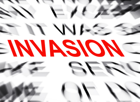 an invasion: Blured text with focus on INVASION