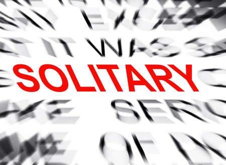 solitary: Blured text with focus on SOLITARY