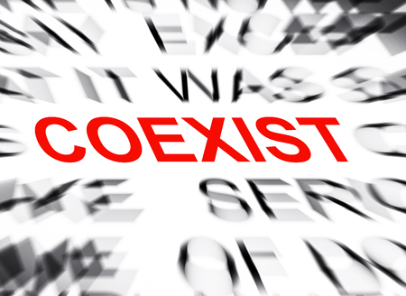 coexist: Blured text with focus on COEXIST Stock Photo