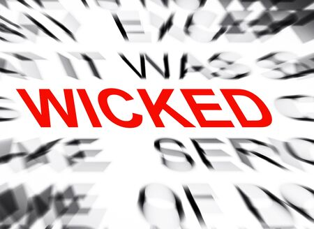 wicked: Blured text with focus on WICKED