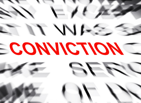 conviction: Blured text with focus on CONVICTION Stock Photo