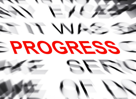 definition define: Blured text with focus on PROGRESS Stock Photo