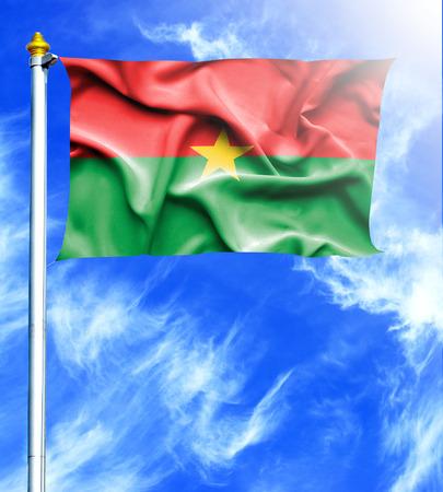 hanged: Blue sky and mast with hanged waving flag of Burkina Faso