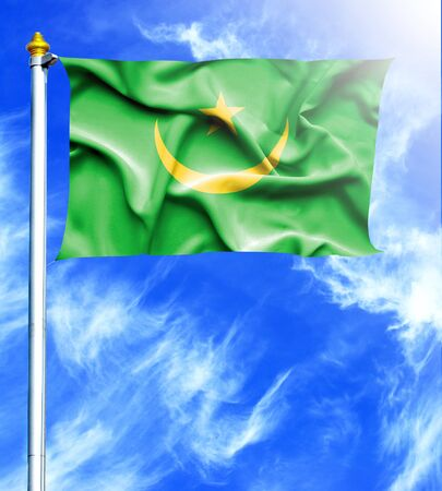 mast: Blue sky and mast with hanged waving flag of Mauritania