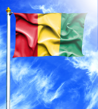 mast: Blue sky and mast with hanged waving flag of Guinea Stock Photo