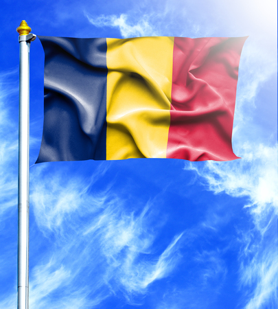 hanged: Blue sky and mast with hanged waving flag of Chad Stock Photo