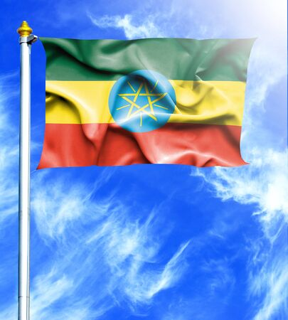 mast: Blue sky and mast with hanged waving flag of Ethiopia