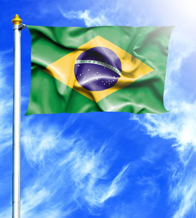 mast: Blue sky and mast with hanged waving flag of Brazil