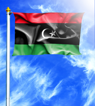 hanged: Blue sky and mast with hanged waving flag of Libya Stock Photo