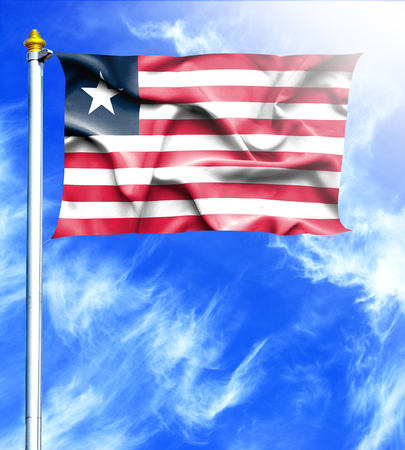 mast: Blue sky and mast with hanged waving flag of Liberia Stock Photo