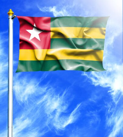 hanged: Blue sky and mast with hanged waving flag of Togo Stock Photo