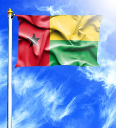 mast: Blue sky and mast with hanged waving flag of Guinea Bissau Stock Photo